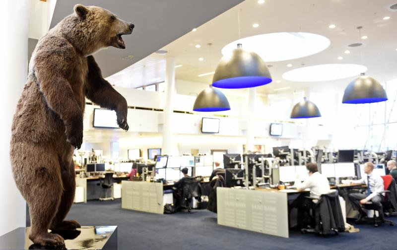 A bear statue is pictured in an office at Danish Saxo bank in Copenhagen, January 22, 2015. The Danish central bank cut its key policy rate on Thursday for the second time this week to defend the crown's peg to the euro after the European Central Bank unveiled a stimulus package that weakened the single currency. REUTERS/Fabian Bimmer (DENMARK - Tags: BUSINESS)