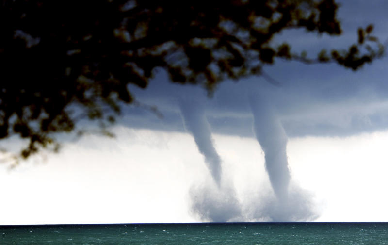 A pair of water spouts form on Lake Michigan southeast of Kenosha, Wis. on Thursday, Sept. 12, 2013. The National Weather Service in Sullivan said the water spouts occurred about four miles southeast from Kenosha. A water spout is basically a tornado over water, meteorologist Ed Townsend said. (AP Photo/The Kenosha News, Kevin Poirier)