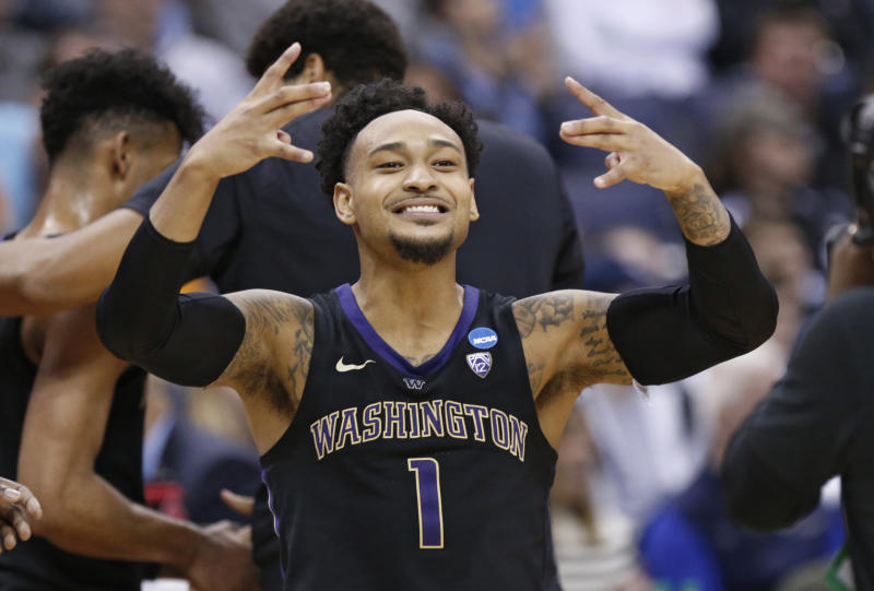 Washington's David Crisp celebrates after his team defeated Utah State during a first round men's college basketball game in the NCAA Tournament in Columbus, Ohio, Friday, March 22, 2019. (AP Photo/Paul Vernon)