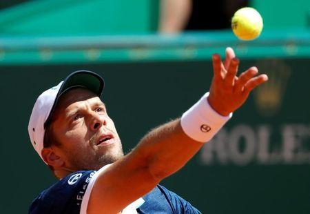 Tennis - Monte Carlo Masters - Monaco, 19/04/2017. Gilles Muller of Luxemburg  serves to Andy Murray of Britain.     REUTERS/Eric Gaillard