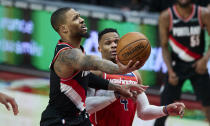 Portland Trail Blazers guard Damian Lillard, left, shoots next to Washington Wizards guard Russell Westbrook during the second half of an NBA basketball game in Portland, Ore., Saturday, Feb. 20, 2021. (AP Photo/Craig Mitchelldyer)