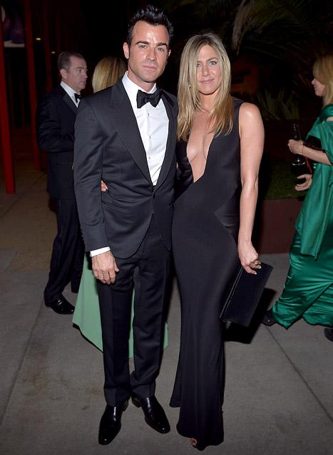 Jennifer Aniston shows some serious skin while out with Justin Theroux