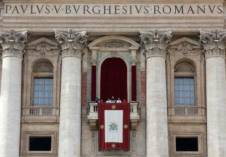 "FILE PHOTO: Pope Francis delivers his ""Urbi et Orbi"" (to the city and the world) message from the balcony overlooking St. Peter's Square at the Vatican"