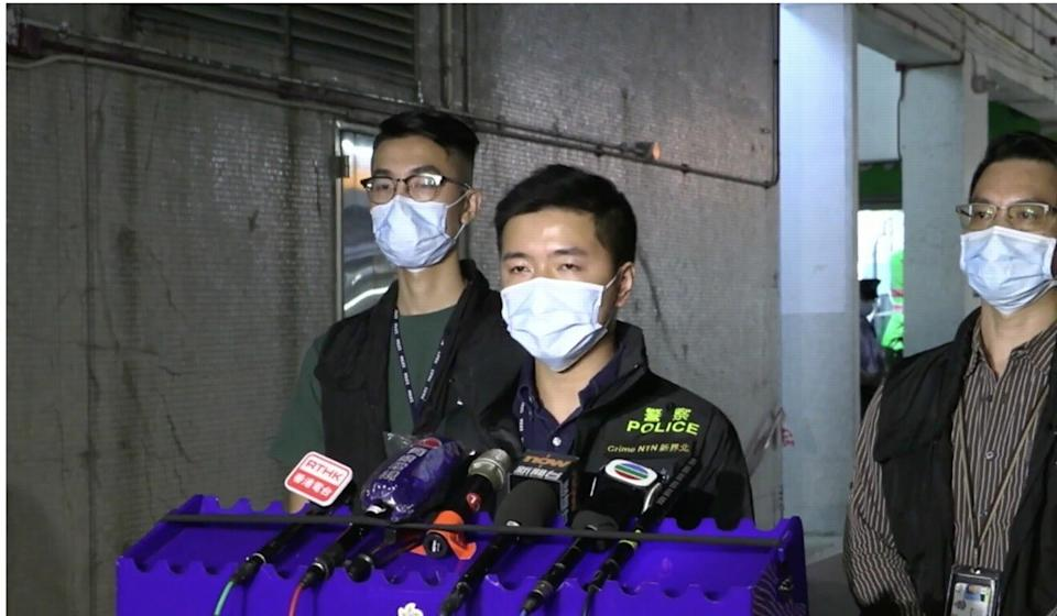 Police officers brief the media on the councillor's arrest. Photo: Hong Kong Police