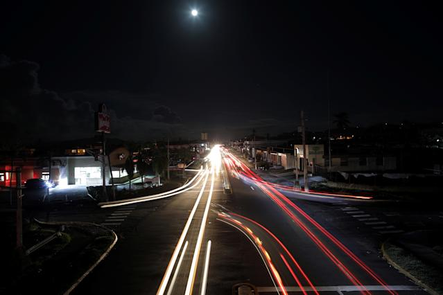 <p>Cars drive in the darkness in a neighbourhood that has no electricity, after Hurricane Maria in Caguas, Puerto Rico, Oct. 4, 2017. (Photo: Carlos Barria/Reuters) </p>