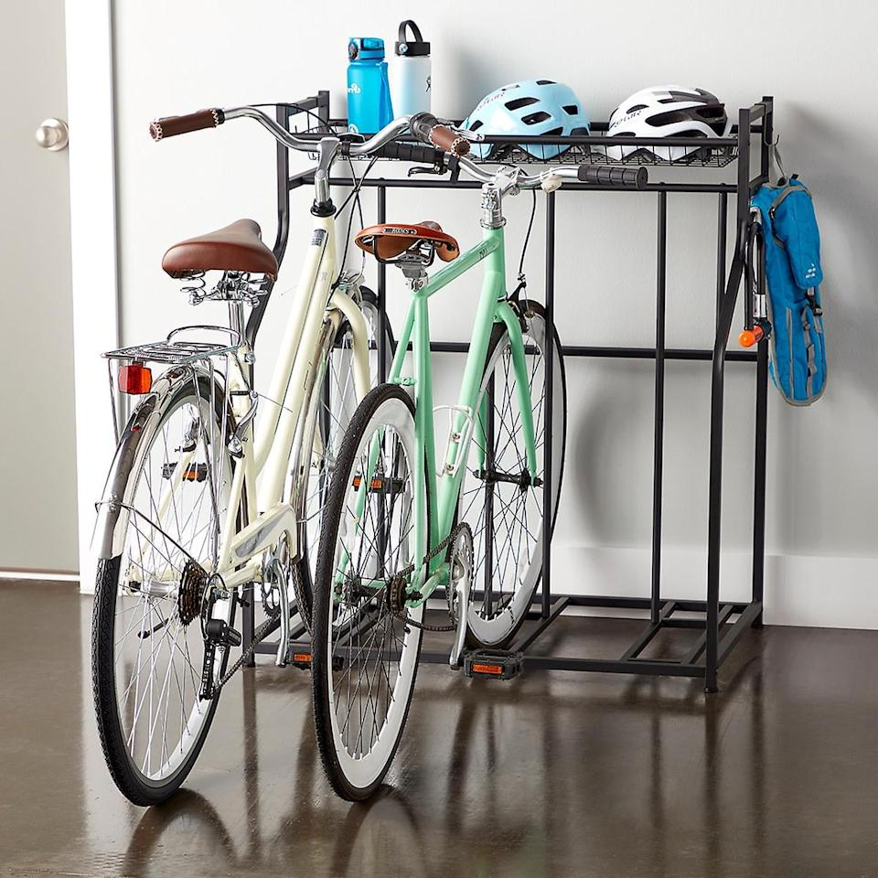 """<p>Don't keep your bikes all in a pile in the corner, keep them in this <a href=""""https://www.popsugar.com/buy/Heavy-Duty-Triple-Bike-Rack-444456?p_name=Heavy-Duty%20Triple%20Bike%20Rack&retailer=containerstore.com&pid=444456&price=75&evar1=casa%3Aus&evar9=46634090&evar98=https%3A%2F%2Fwww.popsugar.com%2Fhome%2Fphoto-gallery%2F46634090%2Fimage%2F46634132%2FHeavy-Duty-Triple-Bike-Rack&list1=shopping%2Corganization%2Cgarage%2Chome%20organization%2Chome%20shopping&prop13=api&pdata=1"""" rel=""""nofollow"""" data-shoppable-link=""""1"""" target=""""_blank"""" class=""""ga-track"""" data-ga-category=""""Related"""" data-ga-label=""""https://www.containerstore.com/s/heavy-duty-triple-bike-rack/d?productId=11008419&amp;q=garage%20organizers"""" data-ga-action=""""In-Line Links"""">Heavy-Duty Triple Bike Rack</a> ($75, originally $100).</p>"""