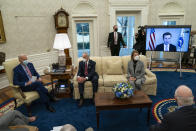 President Joe Biden speaks during a meeting with lawmakers on investments in infrastructure, in the Oval Office of the White House, Thursday, Feb. 11, 2021, in Washington. From left, Biden, Sen. Tom Carper, D-Del., Sen. Shelley Moore Capito, R-W.Va., and Transportation Secretary Pete Buttigieg, on screen. (AP Photo/Evan Vucci)