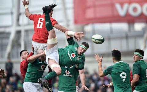 Ireland and Wales contest a line-out - Credit: Charles McQuillan/Getty Images