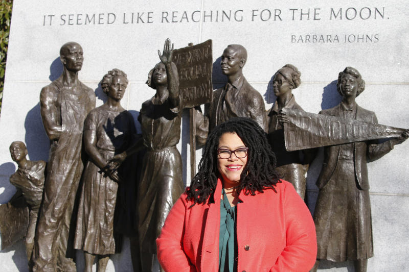 Wake Forest alumni Palinda Carrington poses in front of the Virginia Civil Rights Monument on Capitol Square in Richmond, Va., Sunday, Dec. 15, 2019. The school struggled with racial issues in the last school year and how it's addressed them will be a topic for the new school year. (AP Photo/Steve Helber)