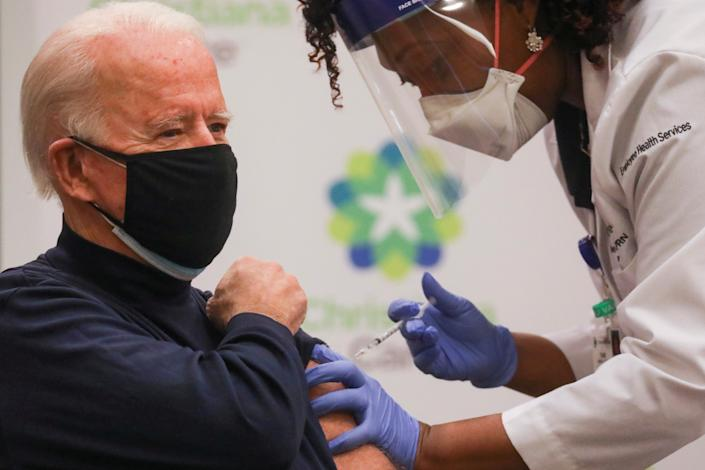 Nurse practitioner Tabe Mase gives U.S. President-elect Joe Biden a dose of a vaccine against the coronavirus disease (COVID-19) at ChristianaCare Christiana Hospital, in Newark, Delaware, U.S. December 21, 2020. REUTERS/Leah Millis     TPX IMAGES OF THE DAY