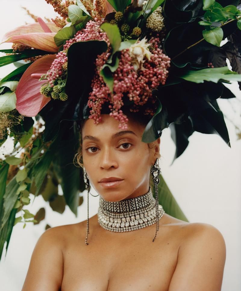 Floral headdress by Phil John Perry for Rebel Rebel. Erickson Beamon earrings. Lynn Ban necklaces.<br />Fashion Editor: Tonne Goodman.