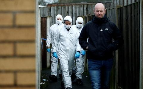 Forensic officers walk outside a property, which is being searched in connection with stabbing on London Bridge, in Stoke-on-Trent - Credit: Reuters