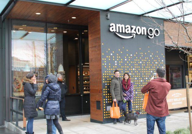 People posed in front of the Amazon Go sign as testers tried out the new service. (GeekWire Photo / Nat Levy)