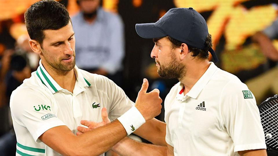 Pictured here, Aslan Karatsev and Novak Djokovic congratulate each other at the end of the match.