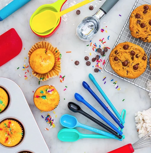 """<p><strong>delish</strong></p><p>delishessentials.com</p><p><strong>$5.99</strong></p><p><a href=""""https://delishessentials.com/collections/baking/products/6pc-piece-plastic-measuring-spoons-multi-colored"""" rel=""""nofollow noopener"""" target=""""_blank"""" data-ylk=""""slk:Shop Now"""" class=""""link rapid-noclick-resp"""">Shop Now</a></p><p>Our sister brand Delish launched an entire line of <a href=""""https://delishessentials.com/"""" rel=""""nofollow noopener"""" target=""""_blank"""" data-ylk=""""slk:kitchen tools and bakeware"""" class=""""link rapid-noclick-resp"""">kitchen tools and bakeware</a>, including these $6 measuring spoons, color-coded to help you find the right size faster while baking.</p>"""