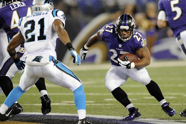 Baltimore Ravens running back Ray Rice, right, runs past Carolina Panthers strong safety Mike Mitchell during the first half of a preseason NFL football game in Baltimore, Thursday, Aug. 22, 2013. (AP Photo/Nick Wass)