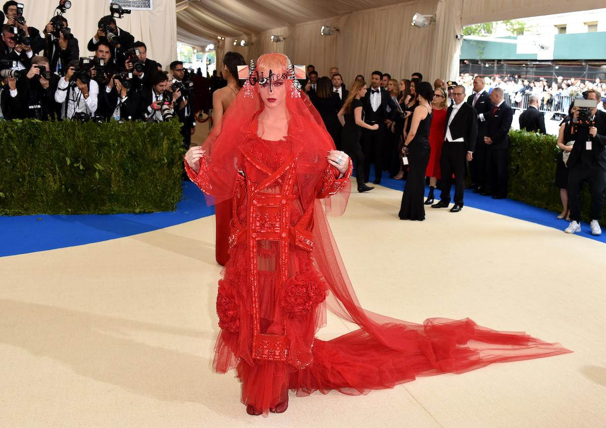 <p>The singer — and one of the co-chairs of the 2017 Met Gala — wore an eccentric, custom red Maison Margiela ensemble. Designed by John Galliano, she paired a red décortiqué embroidered wool coat layered over a red tulle and silk chiffon dress with embroidered satin ribbon embellishment. She paired the piece with a red silk tulle veil and headpiece. (Photo by John Shearer/Getty Images) </p>