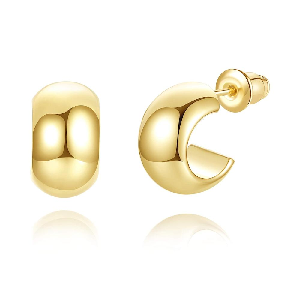 """<strong><h3>14k Gold-Plated Chunky Open-Hoop Earrings</h3></strong><br>A new most wanted steal from this year's Prime Day occasion is this here pair of simply chic hoops that readers carted up like hot cakes yesterday. At under $10, the 14k gold-plated jewelry score with an Amazon's Choice stamp of approval is the perfect sweet gift for yourself or someone special. Reviewers approve them as a lightweight, budget-friendly solution to the much price Jennifer Fisher styles: """"I have a similar pair of Jennifer Fisher solid gold hoops I got as a gift. TBH they're kind of heavy and in the summer I spend a lot of time in the lake. I got these on a whim after utilizing a pair of Madewell tiny hoops as my cheapie gold hoop solution and replacing them every like 1-2 months. I've had these since like... May? And I've worn them probably like 3-4 times a week, in lakes, showered with them on, gotten sunscreen and oil on them, my puppy has chewed on them...honestly, I've just really put them through it. They still look almost new despite like a tiny amount of scratching. They are a perfect size, SO comfortable, look adorable with a low bun, and help me pretend I'm Hailey Bieber. Don't get me wrong, they're not comparable to solid gold jewelry... but if you're like me and actually live life they hold the EFF up. Honestly, if the world ends in 2020 and I have to sell off my gold jewelry and live in a bunker... these are the earrings I would bring. They're THAT good.""""<br><br><strong>4.5 out of 5 stars and 147 reviews</strong><br><br><strong>wowshow</strong> 14k Gold-Plated Chunky Open-Hoop Earrings, $, available at <a href=""""https://amzn.to/33UX2VH"""" rel=""""nofollow noopener"""" target=""""_blank"""" data-ylk=""""slk:Amazon"""" class=""""link rapid-noclick-resp"""">Amazon</a>"""
