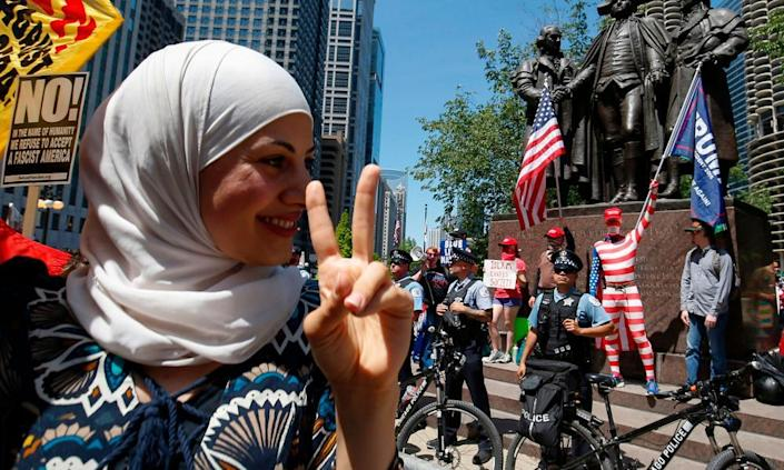 """An activist takes part in a rally against demonstrators at a """"March against sharia"""" protest in Chicago."""