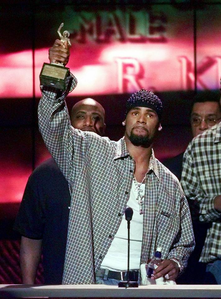 "FILE - In this March 26, 1999 file photo, R. Kelly accepts the Sammy Davis Jr. Award for Male ""Entertainer of the Year"" at the 13th annual Soul Train Music Awards in Los Angeles. In Nov. 1998, his album ""R."" was released and has since sold 6 million copies. (AP Photo/Mark J. Terrill, File)"