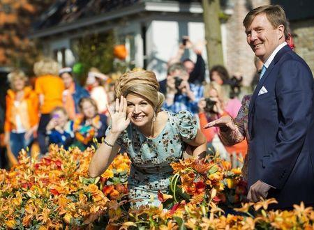 King Willem-Alexander of the Netherlands and his wife Queen Maxima smile during their first King's Day in De Rijp