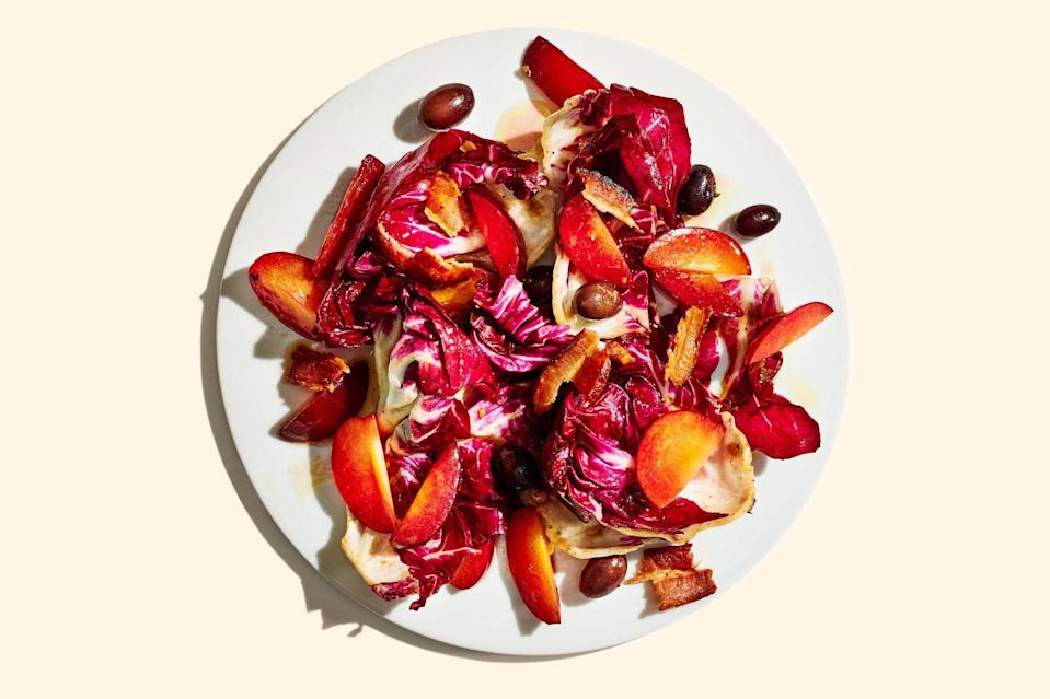 """The salty-sweet (and a little bit sour) combo of bacon, olives, and plums tames bitter radicchio in this late-summer, early-fall salad. <a href=""""https://www.epicurious.com/recipes/food/views/radicchio-and-plum-salad?mbid=synd_yahoo_rss"""" rel=""""nofollow noopener"""" target=""""_blank"""" data-ylk=""""slk:See recipe."""" class=""""link rapid-noclick-resp"""">See recipe.</a>"""