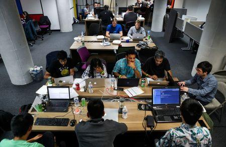 People work on their computers during a weekend Hackathon event in San Francisco, California, U.S. July 16, 2016. REUTERS/Gabrielle Lurie