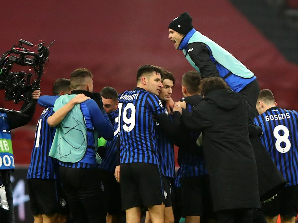 Atalanta players celebrate beating Ajax in the group stage (Getty Images)