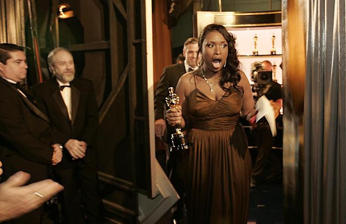 2007: Jennifer Hudson is open-mouthed in excitement exiting the stage with her supporting actress Oscar