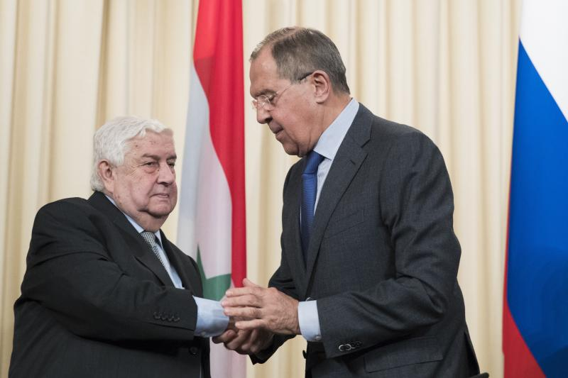 Russian Foreign Minister Sergey Lavrov, right, shakes hand with Syrian Foreign Minister Walid Muallem, after a shared press conference with Iranian Foreign Minister Mohammad Javad Zarif following their talks focused on Syria in Moscow, Russia, Friday, April 14, 2017. (AP Photo/Pavel Golovkin)