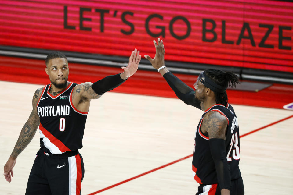 Damian Lillard (0) helped ice a 20-leg parlay at BetMGM. (Photo by Steph Chambers/Getty Images)