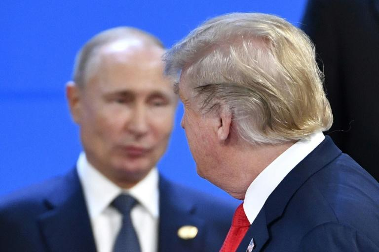 US President Donald Trump looks at Russia's President Vladimir Putin as they pose for photos at the Group of 20 summit in November 2018 in Buenos Aires, where they did not formally meet