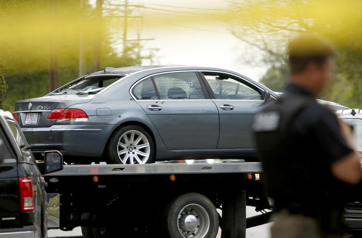 FILE - In this April 21, 2021 file photo, a car that was damaged in a police involved shooting is removed from the scene in Elizabeth City, N.C. Many police departments — including in large U.S. cities such as New York and Chicago — ban or strictly limit shooting into moving vehicles after concluding that the practice is ineffective and not worth the risk to human life. But it is still happening and defended as a justifiable use of force in other areas, including the small municipality of Elizabeth City. (Stephen M. Katz/The Virginian-Pilot via AP)