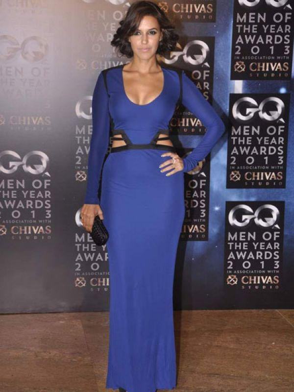 "<p><strong>Image courtesy : iDiva.com</strong></p><p><strong>Neha Dhupia</strong>: Neha was recently spotted in a stunning cutout Roberto Cavalli outfit. Her blue long dress had black panelling around her waist. We think it is smoking!<br /><br /><strong>Celeb Trend: <a href=""http://idiva.com/photogallery-style-beauty/celeb-trend-bollywood-actresses-ditch-the-dupatta/24105"" target=""_blank"">Bollywood Actresses Ditch the Dupatta</a></strong></p><p><strong>Related Articles - </strong></p><p><a href='http://idiva.com/photogallery-style-beauty/celeb-trend-of-the-colour-blue-nude-heels/16925' target='_blank'>Celeb Trend: Of The Colour Blue and Nude Heels</a></p><p><a href='http://idiva.com/photogallery-style-beauty/vote-sexiest-b-town-actress-in-cobalt-blue/21370' target='_blank'>Vote: Sexiest B-Town Actress in Cobalt Blue</a></p>"