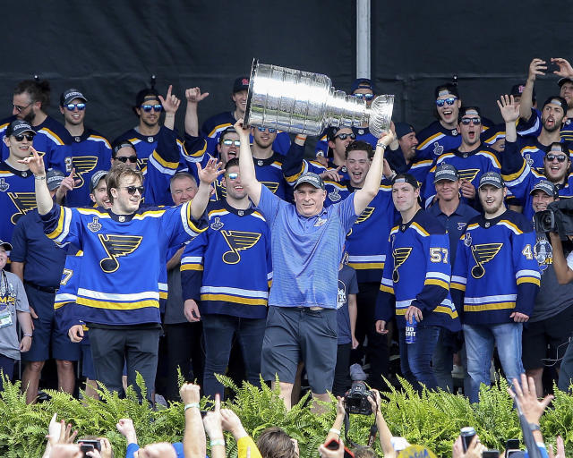 St. Louis Blues head coach Craig Berube holds the Stanley Cup overhead during the NHL hockey Stanley Cup victory celebration in St. Louis on Saturday, June 15, 2019. (AP Photo/Scott Kane)