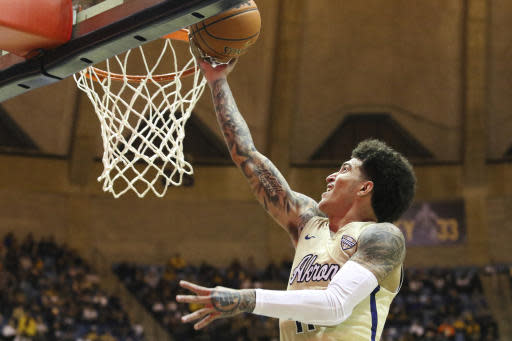 Akron's Loren Cristian Jackson goes to the basket against West Virginia during an NCAA college basketball game, Friday, Nov. 8, 2019, in Morgantown, W.Va. (AP Photo/Kathleen Batten)