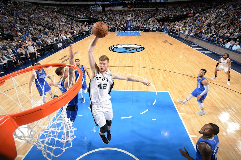 DALLAS, TX - MARCH 12: Davis Bertans #42 of the San Antonio Spurs dunks the ball against the Dallas Mavericks on March 12, 2019 at the American Airlines Center in Dallas, Texas. NOTE TO USER: User expressly acknowledges and agrees that, by downloading and/or using this photograph, user is consenting to the terms and conditions of the Getty Images License Agreement. Mandatory Copyright Notice: Copyright 2019 NBAE (Photo by Glenn James/NBAE via Getty Images)