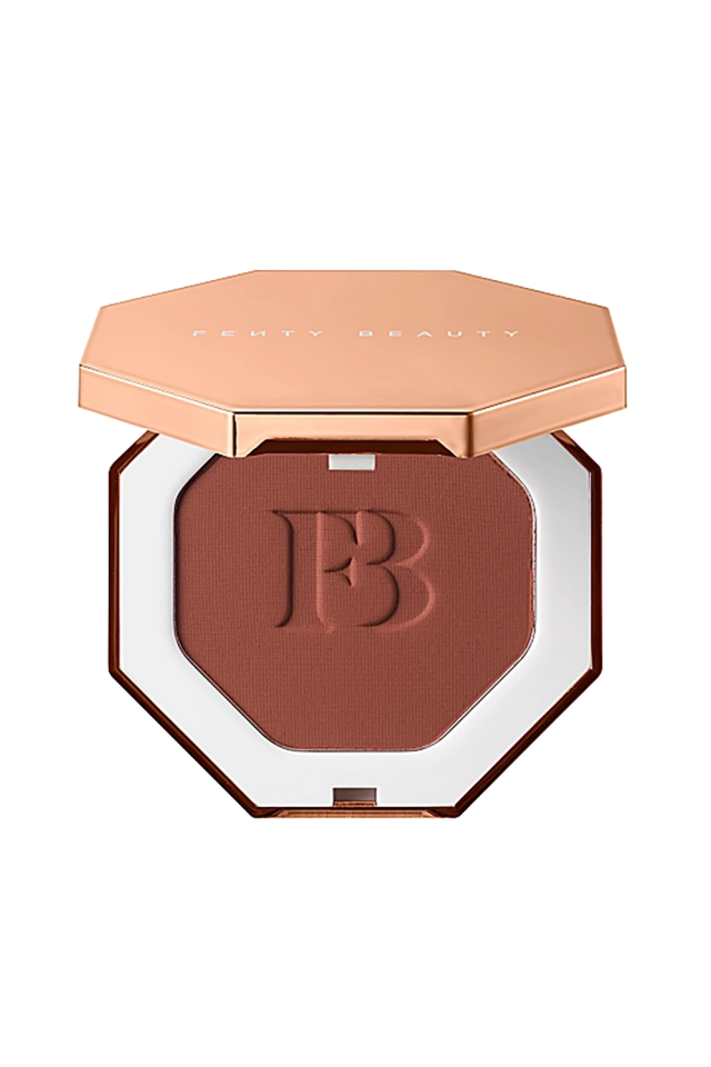 "<p><strong>Fenty Beauty</strong></p><p>sephora.com</p><p><strong>$30.00</strong></p><p><a href=""https://go.redirectingat.com?id=74968X1596630&url=https%3A%2F%2Fwww.sephora.com%2Fproduct%2Fsun-stalk-r-instant-warmth-bronzer-P55978864&sref=http%3A%2F%2Fwww.marieclaire.com%2Fbeauty%2Fmakeup%2Fg4879%2Fbest-self-tanners-bronzers-dark-skin%2F"" target=""_blank"">SHOP IT</a></p><p>You can certainly trust Rihanna, a glowing queen, to make a bronzer the sun won't stand a chance against. Whether you're looking to carve out your cheekbones for a snatched contour, or add a bit of warmth to amp up your glow this velvety bronzer will hold up for hours on end. </p>"
