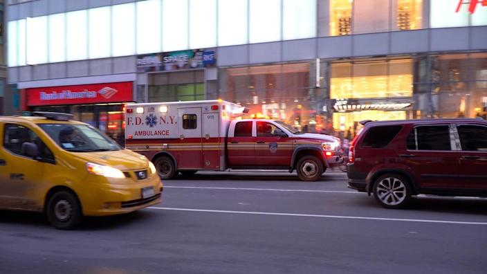 Ambulance in evening responding to an emergency medical situation in Manhattan