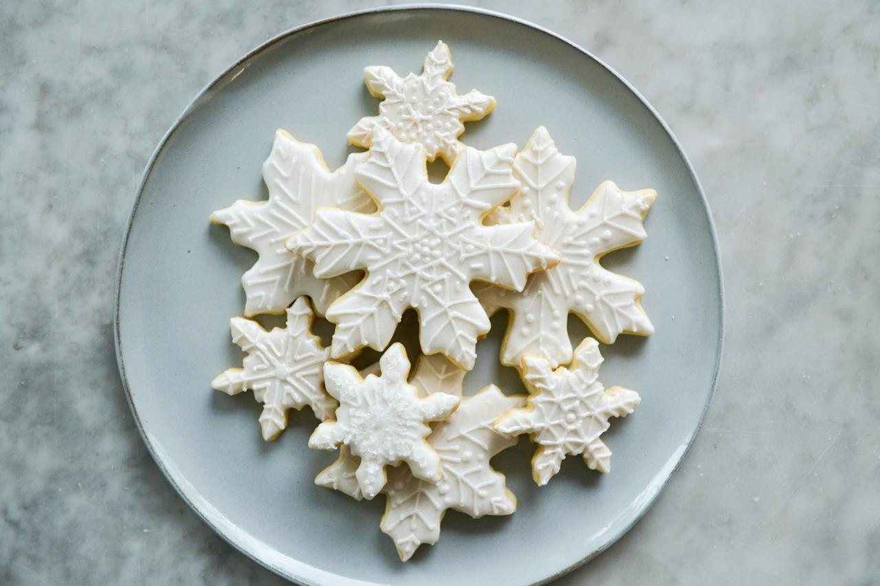 """<p><strong>Recipe: <a href=""""https://www.southernliving.com/recipes/snowflake-sugar-cookies"""">Snowflake Sugar Cookies</a></strong></p> <p>Nothing says Christmas like a batch of iced snowflake cookies. These are best baked then frozen, but leave the icing until after thawed.</p>"""