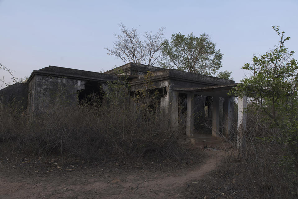 A ruined Anglo-Indian bungalow shows the ravages of time it has failed to withstand.