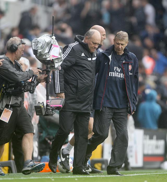 Arsene Wenger manager of Arsenal and Martin Jol Manager of Fulham during the Barclays Premier League match at Craven Cottage, London.