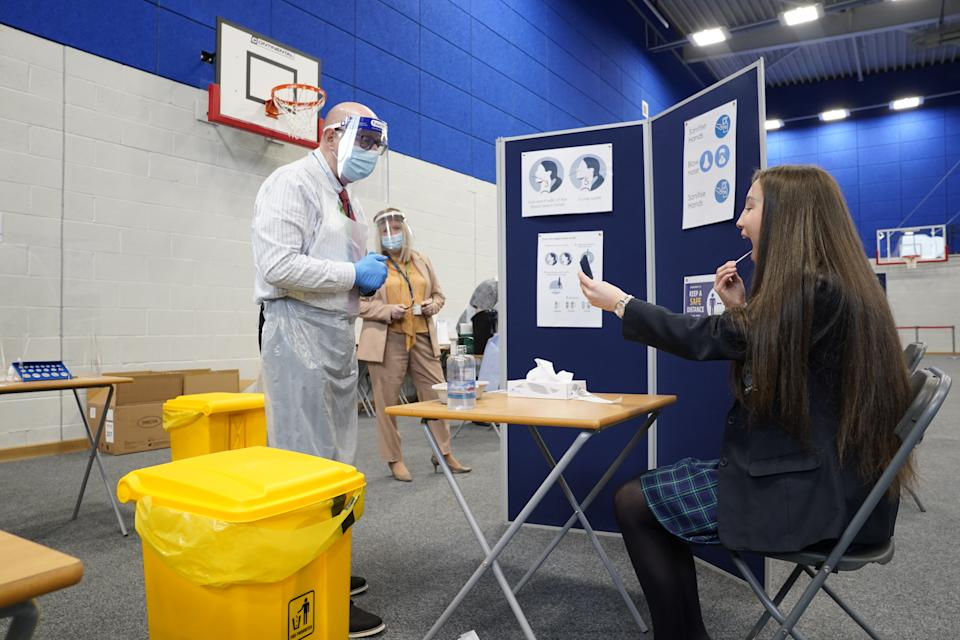 Children having Lateral Flow Tests at Our Lady and St Bede Catholic Academy in Stockton-on-Tees in County Durham, as pupils in England return to school for the first time in two months as part of the first stage of lockdown easing. Picture date: Monday March 8, 2021.