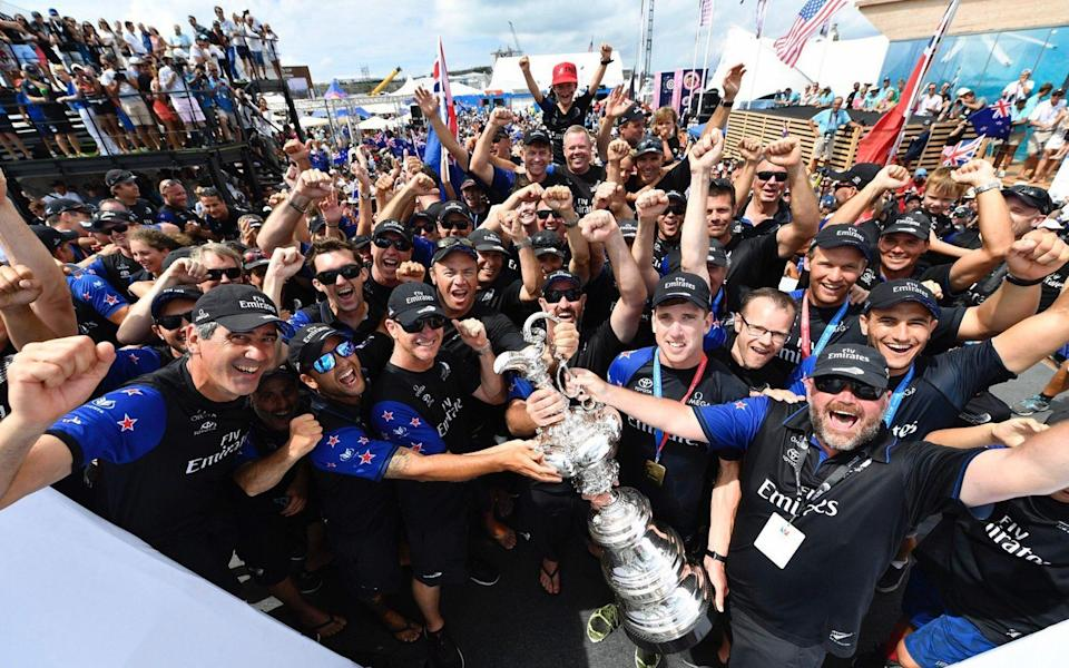 Emirates Team New Zealand celebrate winning the famous America's Cup trophy in 2017 - RICARDO PINTO