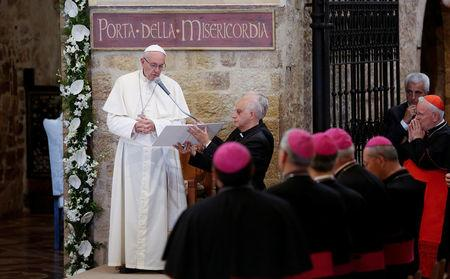 FILE PHOTO: Pope Francis speaks outside the Porziuncola, the chapel inside the Saint Mary of Angels Basilica, in the pilgrimage town of Assisi, central Italy, August 4, 2016. REUTERS/Remo Casilli/File Photo