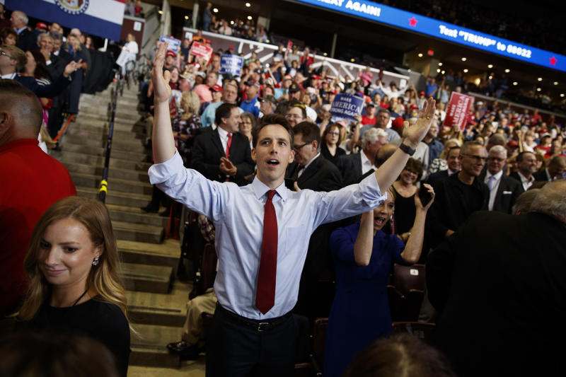 Republican Senate candidate Josh Hawley dances before President Donald Trump speaks during a campaign rally, Friday, Sept. 21, 2018, in Springfield, Mo. (AP Photo/Evan Vucci)