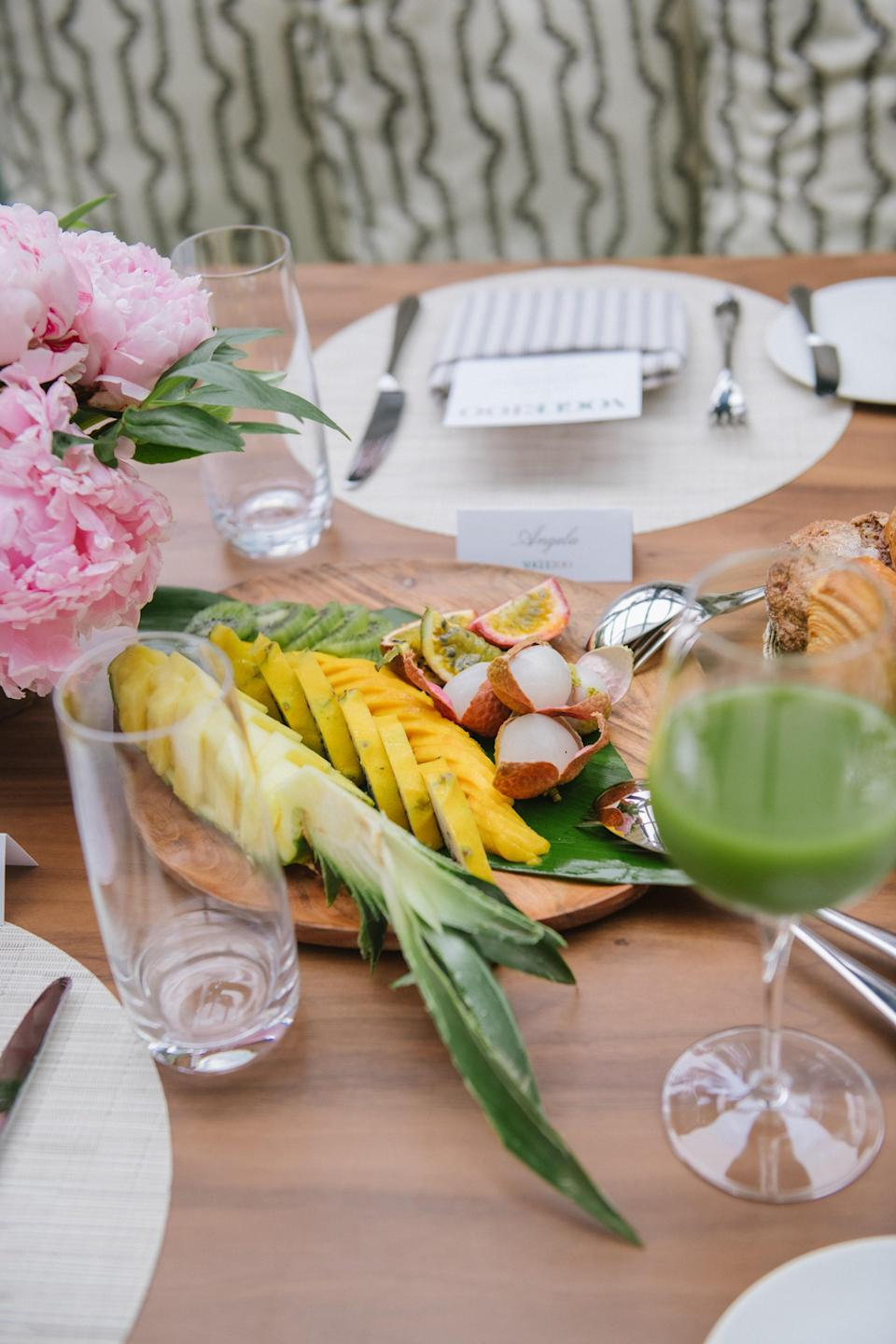 The exotic fruit platter, buttery pastries, and freshly squeezed green juice.
