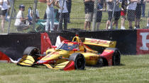 Ryan Hunter-Reay hits the tire barrier after going off the track on the first lap during an IndyCar race at Mid-Ohio Sports Car Course in Lexington, Ohio, Sunday, July 4, 2021. (AP Photo/Tom E. Puskar)