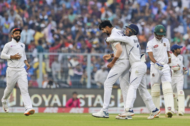 India's Ishant Sharma, second left, and Mayank Agarwal, second right, celebrate the dismissal of Bangladesh's Ebadot Hossain, right, during the first day of the second test match between India and Bangladesh, in Kolkata, India, Friday, Nov. 22, 2019. (AP Photo/Bikas Das)
