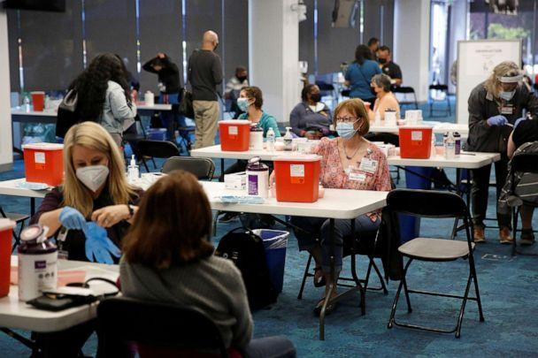 PHOTO: Ravenswood Family Health Center staff and volunteers give coronavirus disease (COVID-19) vaccines at a newly opened vaccination site at Facebook headquarters in Menlo Park, Calif., April 10, 2021. (Brittany Hosea-small/Reuters)
